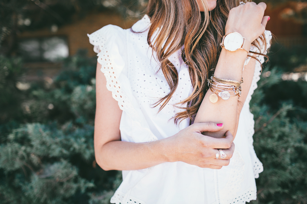 girl with arm up wearing alex and ani bracelet and arvo watch