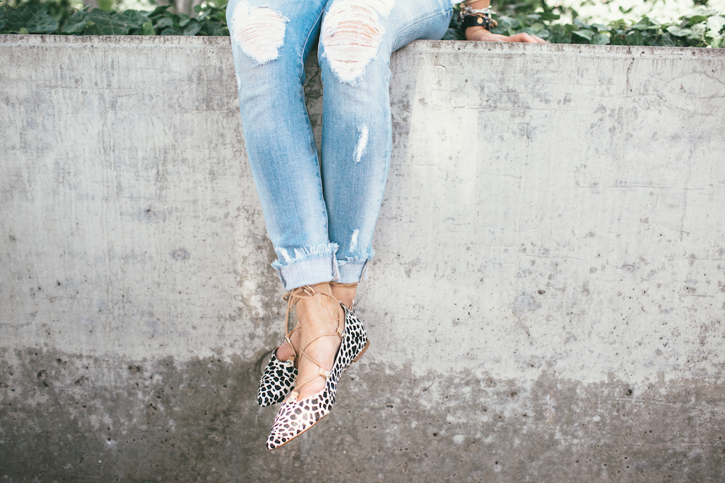 Distressed denim with fringe on the bottom with lace up leopard flats