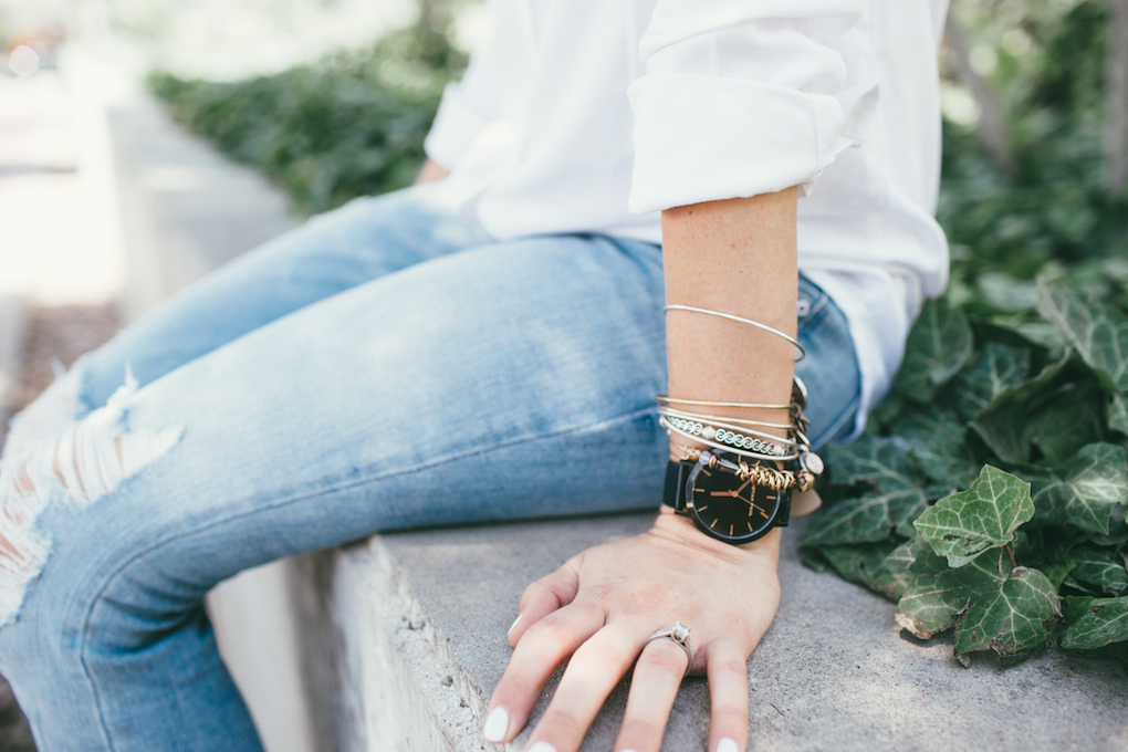 Clause watch with Alex and ani bracelets paired with white button up and distressed denim