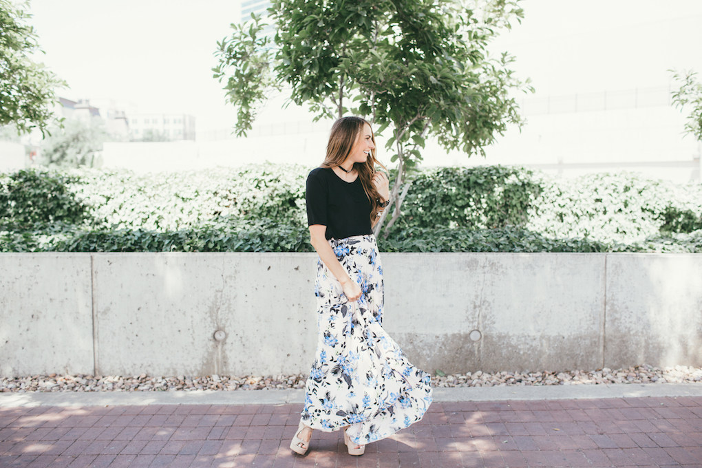 mom in floral pleated skirt with black top