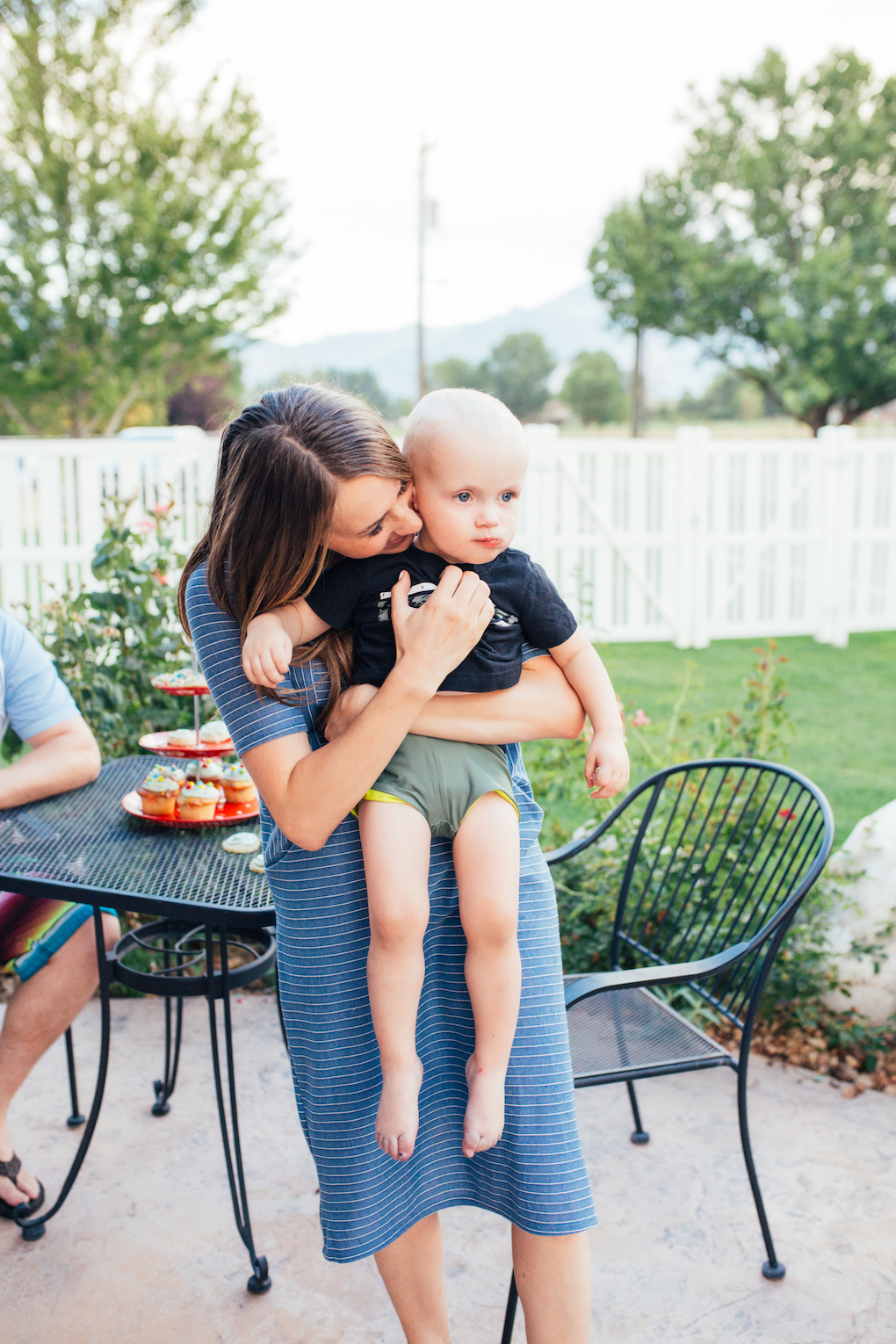 KINGS HAPPY UN-BIRTHDAY - KIDS BALL PARTY by Utah blogger Dani Marie - Mom hugging toddler in blue stripe dress and green swim shorts