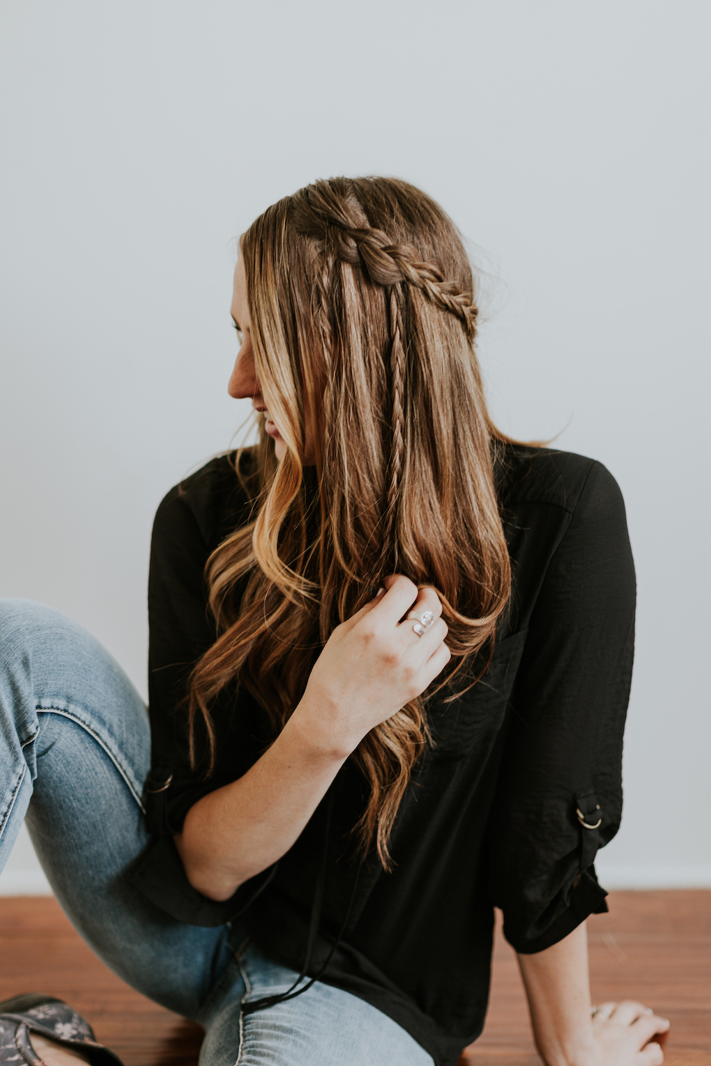girl in black lace up top with braided bohemian hairstyle tutorial