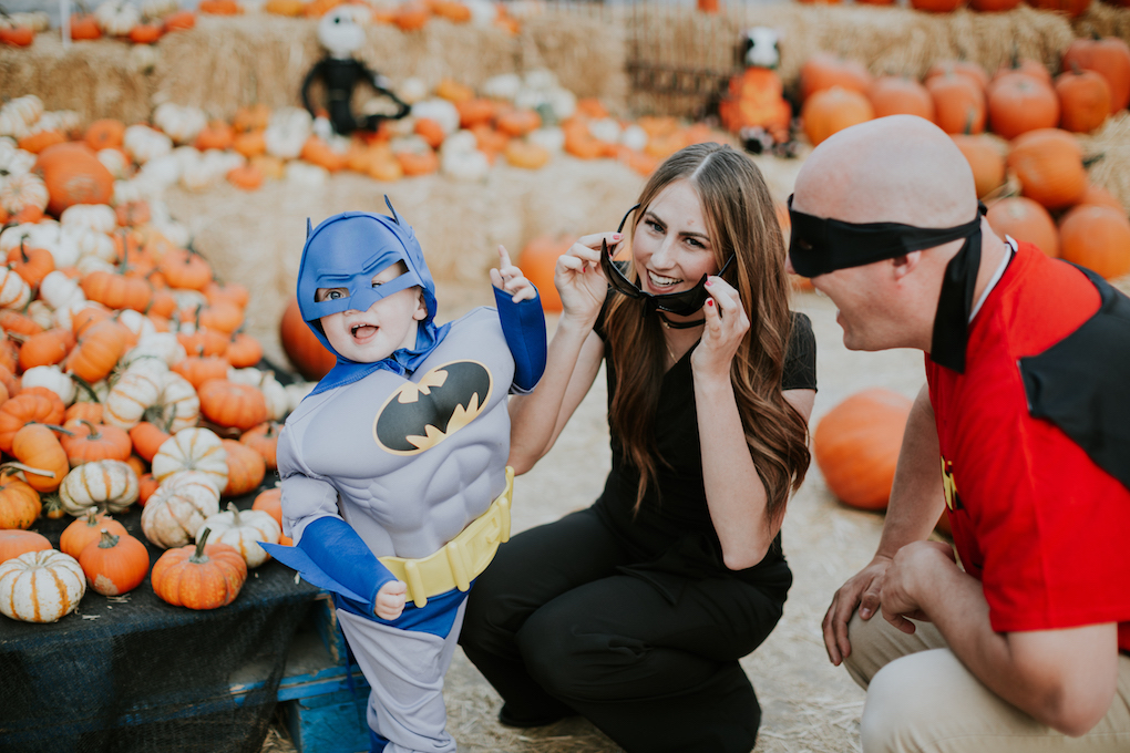 family halloween costume of mom and little boy as batman and batgirl
