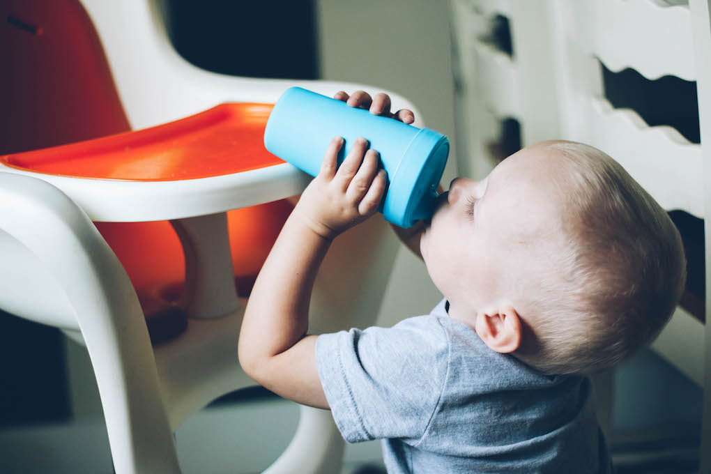 little boy drinking out of re-play sippy cup