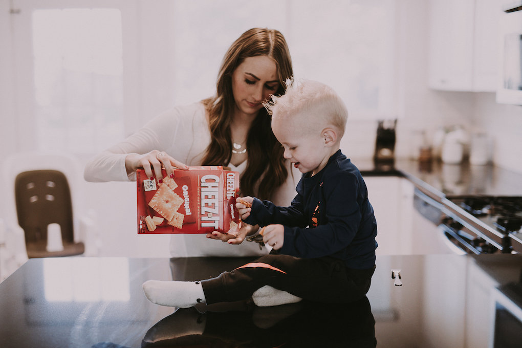 mom and little boy eating cheez-it crackers