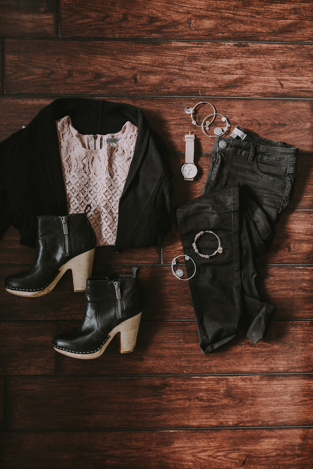 light pink lace top with a black cardigan and black distressed jeans and black booties