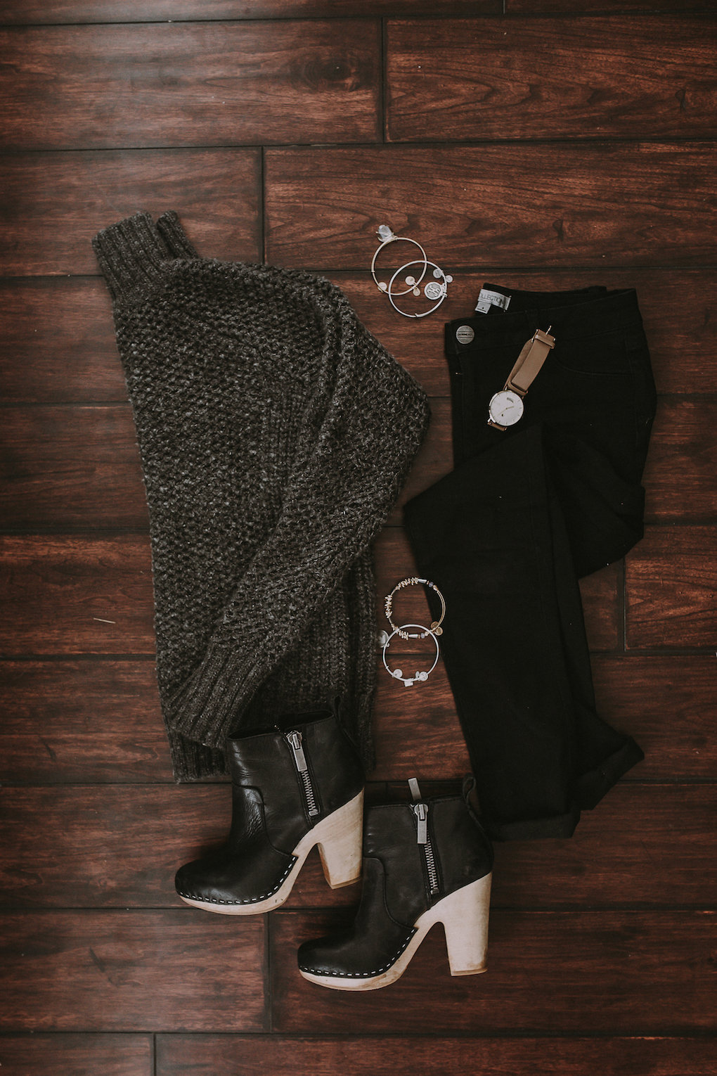 thick oversized grey knit turtleneck with black jeans and black booties