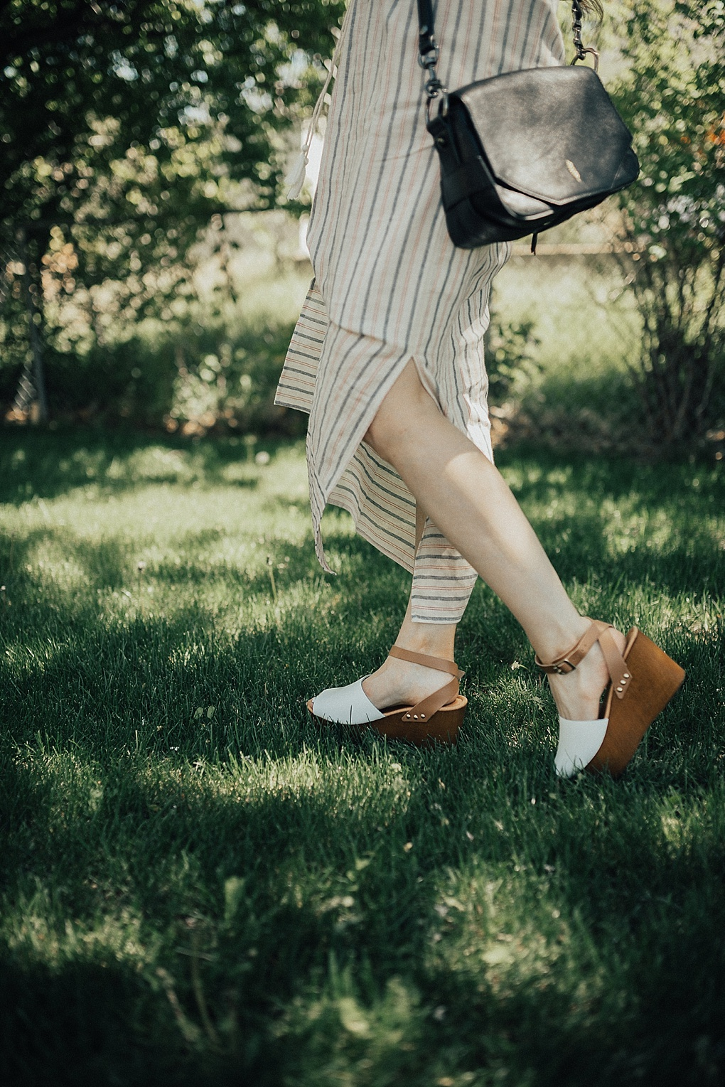 cream navy red stripe tank top maxi dress with white and tan platform sandals on long brown hair with caramel highlights black thacker nyc cross body bag