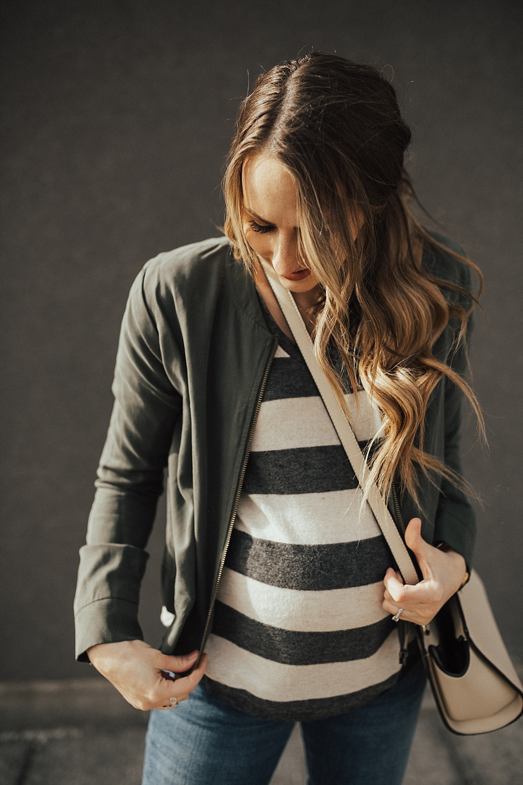 Save this Post! Utah style blogger Dani Marie styles a striped shirt and military jacket.