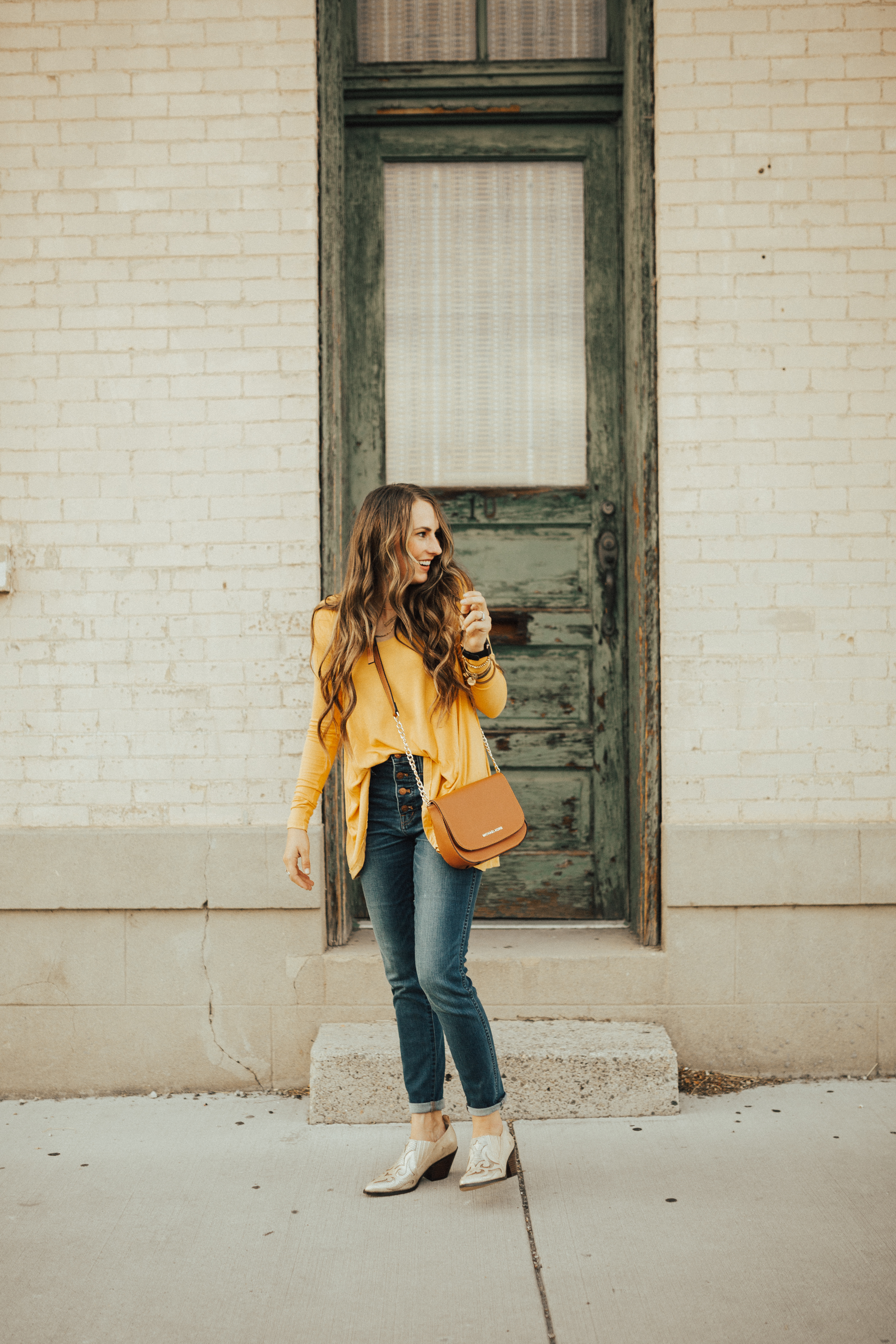 Moms lets get ready for Fall in style. Utah Style Blogger Dani Marie is sharing her top 13 mom friendly fall outfits that will keep you stylish all season long!